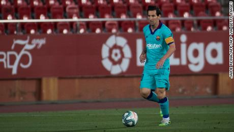 Lionel Messi dribbles during Barcelona's game at Mallorca on Saturday behind closed doors.