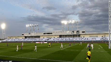 """Real Madrid chose to use the empty stands at the Estadio Alfredo di Stefano to display a banner reading """"In our hearts"""" paying tribute to coronavirus victims."""