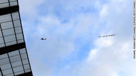 """A plane flies over the Etihad Stadium with a banner reading """"White Lives Matter Burnley."""""""