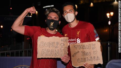 Liverpool fans celebrate their team winning the Premier League title outside Anfield.