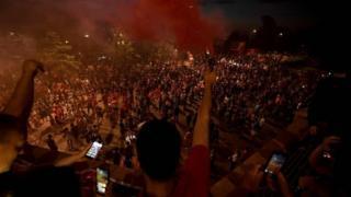Fans celebrate Liverpool winning the Premier League title