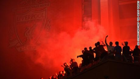 Fans outside Anfield, celebrating Liverpool's historic win.
