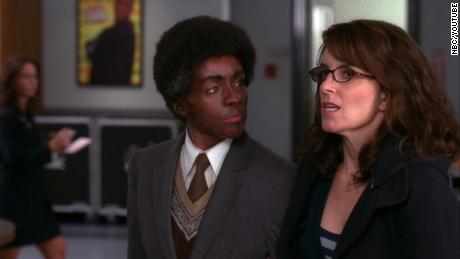 """Jane Krakowski, left, appears in blackface in an episode of the third season of """"30 Rock"""" in which her character, a White woman, dresses as a Black man while Black comedian Tracy Morgan dresses as a White woman."""