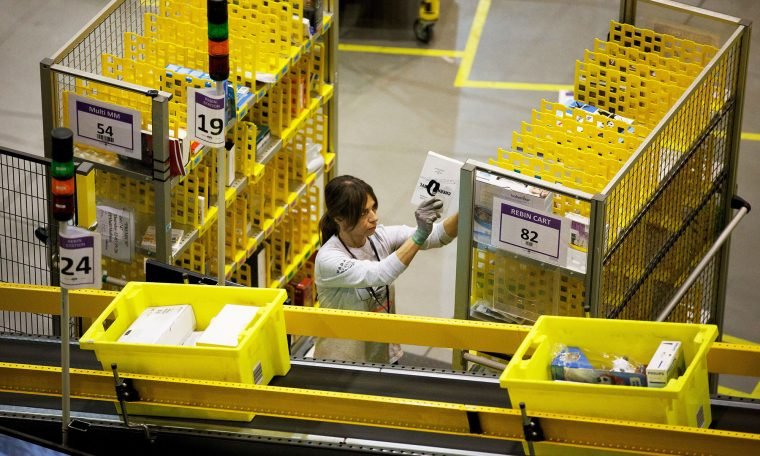 Amazon tests wearable social distancing device for warehouse workers