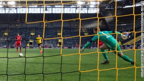 Neuer in action during the Bundesliga match between Bayern and Borussia Dortmund at Signal Iduna Park on May 26, 2020.