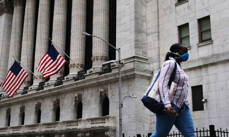 Dow futures rise 100 points as Wall Street tries to end the week on a high note