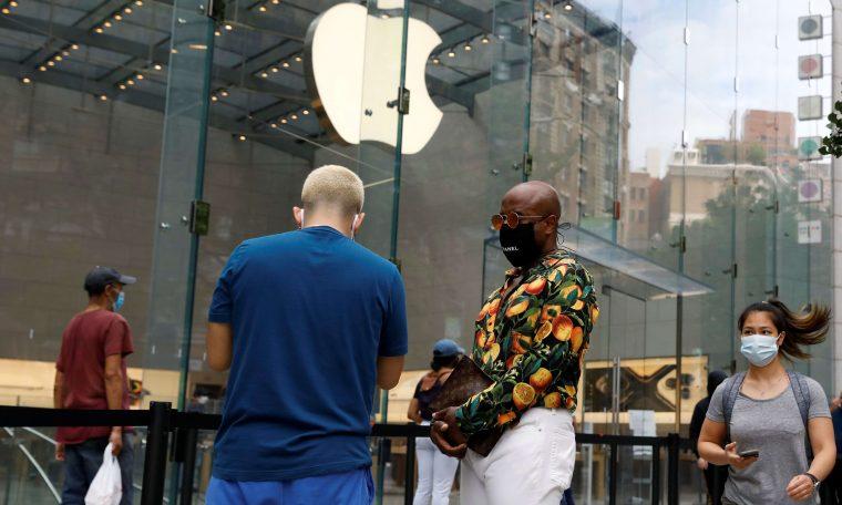 Nasdaq hits record high as Apple rises, Dow jumps 200 points