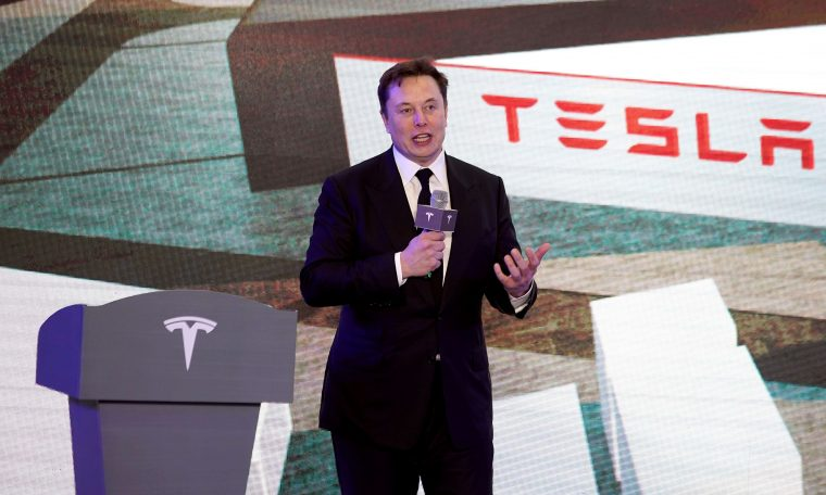 Tesla shares hit record closing price
