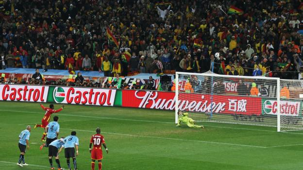 Gyan's penalty skims off the top of the bar