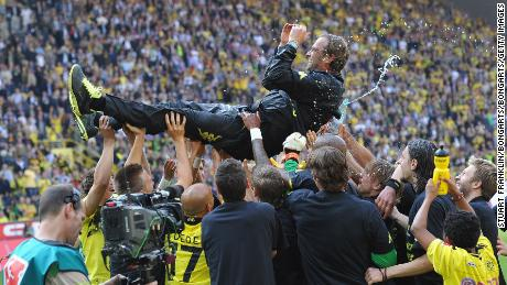 Klopp is tossed in the air by his players after winning the league title at the end of the Bundesliga match between Dortmund and FC Nuernberg on April 30, 2011.
