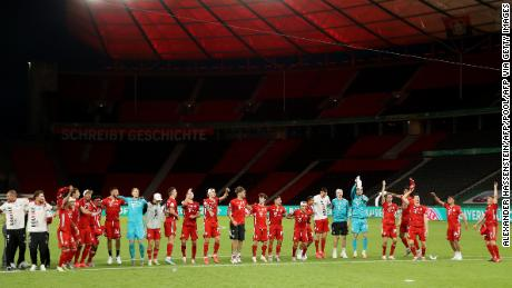 Bayern players celebrate winning the German Cup in a totally empty Olympiastadion.