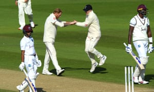 Stokes celebrates with Dom Bess after taking the wicket of Holder for five.