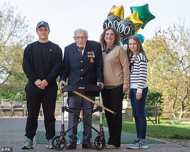 Colonel Tom, pictured with his grandson Benji, daughter Hannah and granddaughter Georgia, received a special nomination for knighthood from the Prime Minister