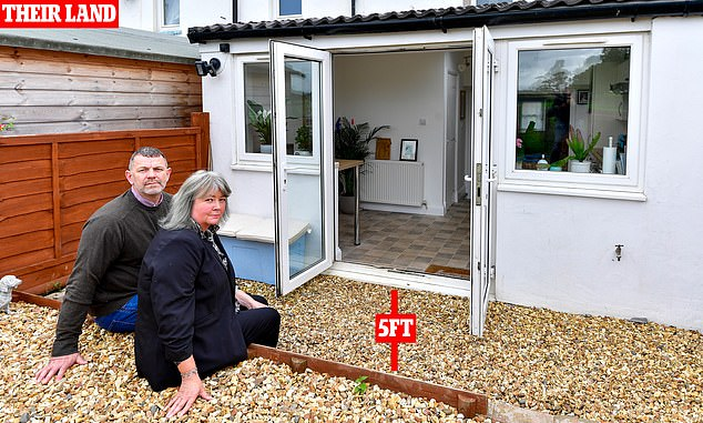 Sold short: Rebecca and David French own less than a fifth of the garden at their Cumbrian cottage
