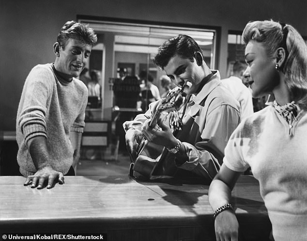 Film breakthrough: Saxon also starred alongside Sal Mineo in the musical comedy Rock, Pretty Baby in 1956; he is pictured with Rod McKuen and April Kent