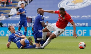 Anthony Martial of Manchester United is tackled by Wes Morgan of Leicester City leading to a penalty.