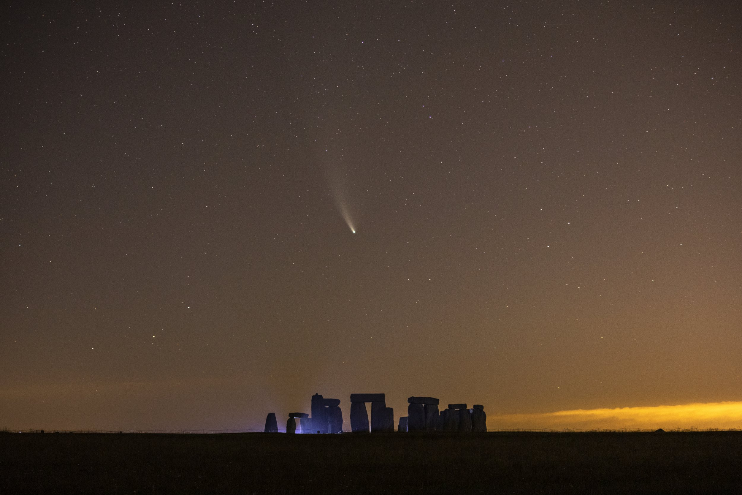 European Best Pictures Of The Day - July 21 - SALISBURY, ENGLAND - JULY 21: Comet NEOWISE passes over Stonehenge in the early hours of July 21, 2020 in Salisbury, England. Comet NEOWISE, the brightest seen in the Northern Hemisphere in 25 years, was discovered by Nasas Near-Earth Object Wide-field Infrared Survey Explorer (NEOWISE) mission on March 27. The comet is currently visible after sunset and will have its closest encounter with Earth on July 23 when it will be around 64 million miles away. (Photo by Dan Kitwood/Getty Images)