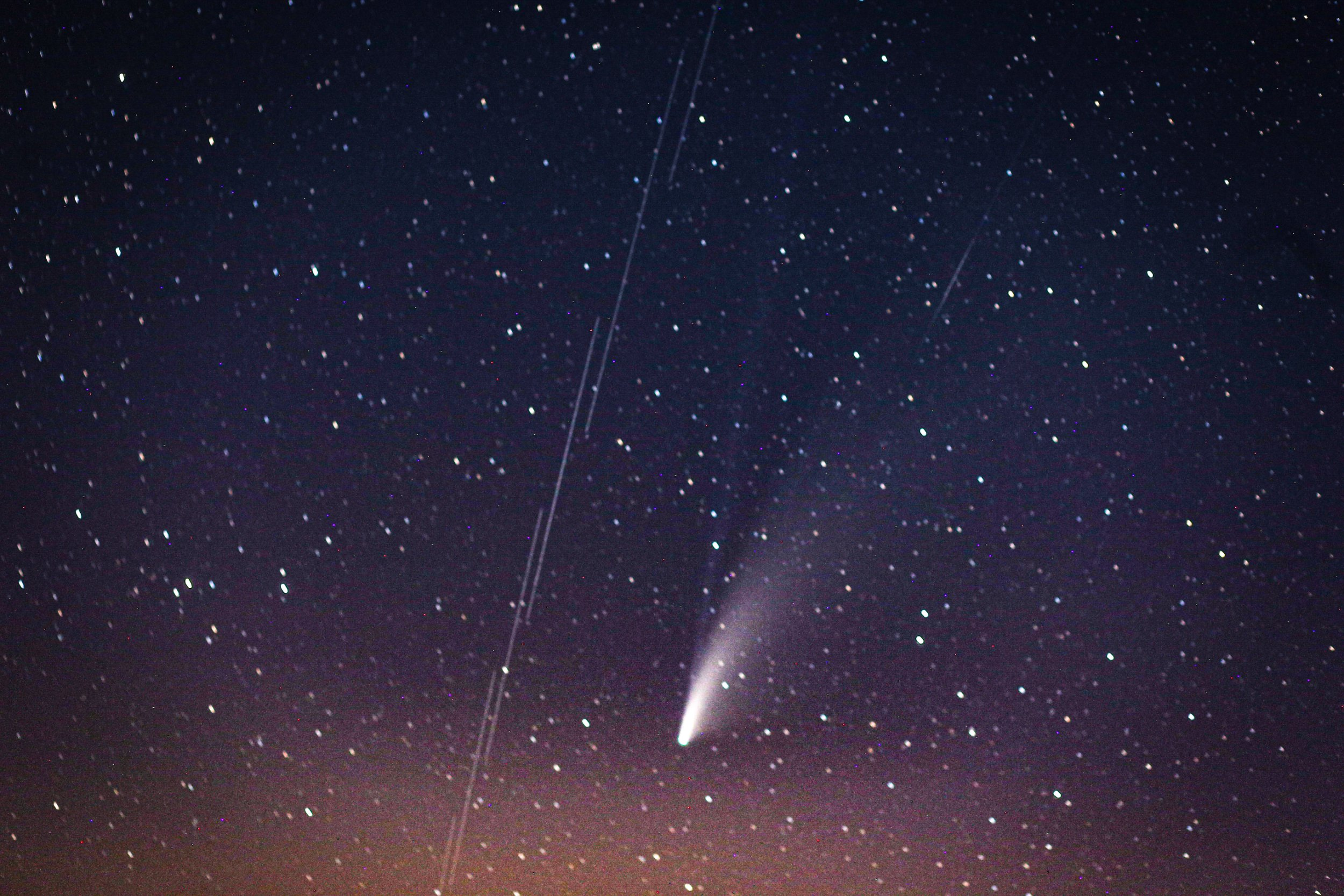 """IDLIB, SYRIA - JULY 20: Comet Neowise, the """"C / 2020 F3 Neowise comet"""" is observed over the sky in Idlib, Syria on July 20, 2020. The """"C / 2020 F3 Neowise comet"""", named after the """"NEOWISE"""" recently discovered comet by telescope of the US Aviation and Space Agency. (Photo by Muhammed Said/Anadolu Agency via Getty Images)"""