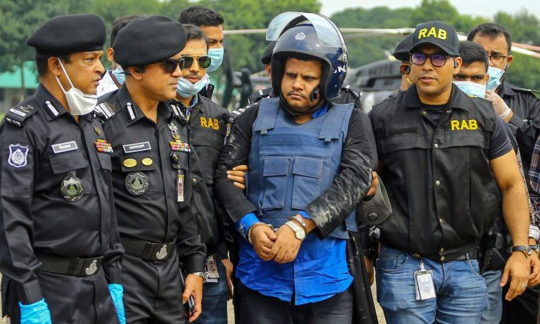 Mohammed Shahed, centre, was arrested near the Indian border on Wednesday