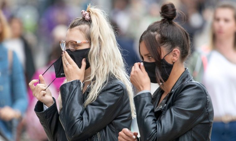 Shoppers wear protective face masks in Edinburgh's Princes Street.