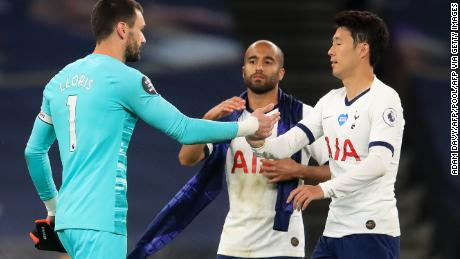 Tottenham goalkeeper Hugo Lloris embraces striker Son Heung-Min after the game.