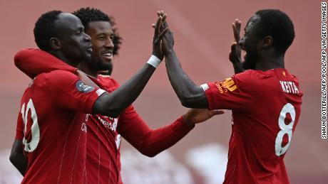 Liverpool celebrates Sadio Mane's opening goal against Aston Villa.