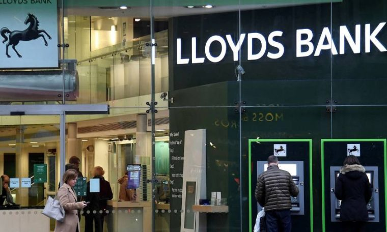 Lloyds slumps to loss after warning on UK outlook