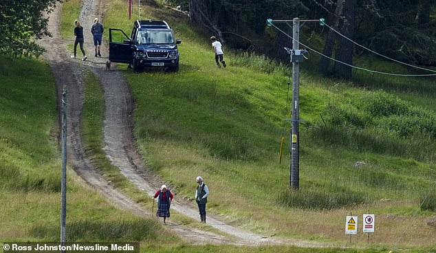 The Queen took to the hills and appeared to be in good company, as three people - who may be Sophie Wessex and her two children,Lady Louise Windsor and James, Viscount Severn, stepped out of the car