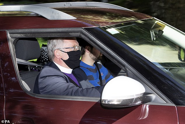 Rev Kenneth MacKenzie wearing a protective face mask arrives at Crathie Kirk ahead of the Sunday Service where Queen Elizabeth II usually attends during her summer break at Balmoral