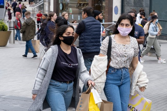 With most shops now open but with retail sales suffering due to the Coronavirus pandemic, shoppers wearing face masks, which became compulsory in shops on the 24th July, go out shopping in the city centre on 5th August 2020 in Birmingham, United Kingdom. Coronavirus or Covid-19 is a respiratory illness that has not previously been seen in humans. While much or Europe has been placed into lockdown, the UK government has put in place more stringent rules as part of their long term strategy, and in particular social distancing. (photo by Mike Kemp/In PIctures via Getty Images)