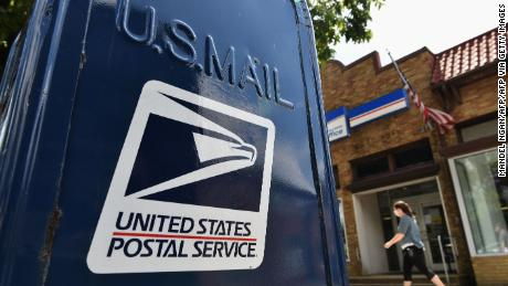 Postal Service backs down on changes as at least 20 states sue over potential mail delays ahead of election