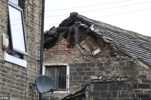 The chimney collapsed off the roof of the house at 5.06am in high winds and rain