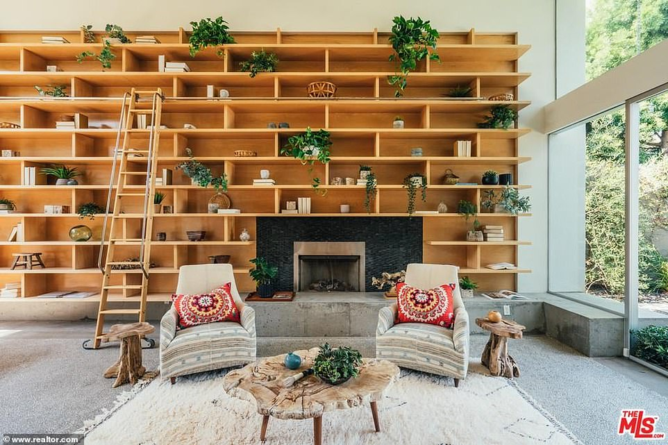 A better look:There is plenty of space for parties with a wide fireplace for cozy evenings and built-in light wood bookshelves to store her favorite page turners as well as knickknacks