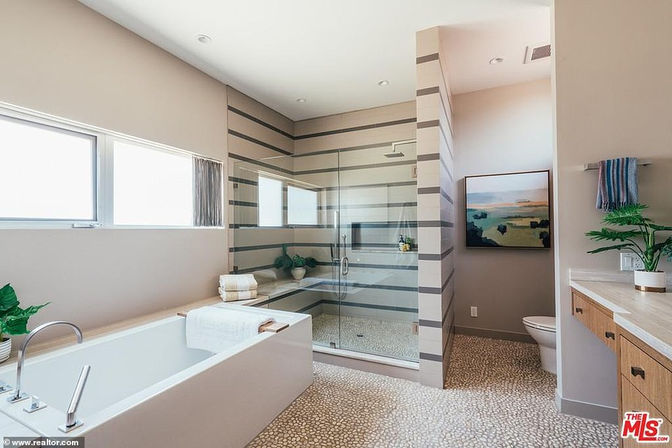 Great for a long and relaxing spa day:A bathroom is attached and offers a rectangular bathtub with a steam shower