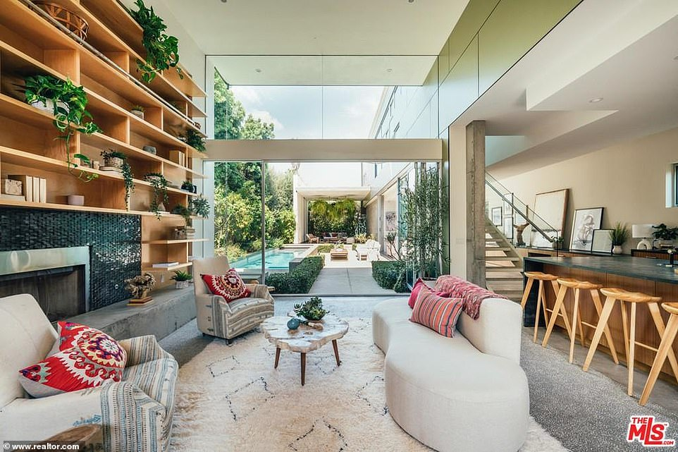 Party zone:The best room in the house is the oversized living room with 15-foot ceilings and a glass wall that looks out to the back yard