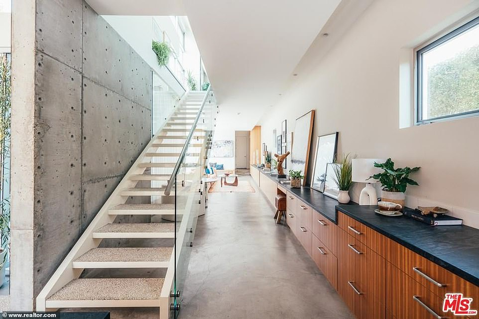 Can't be missed:There is a long staircase that commands attention with a 'floating' feel as there is open between the steps and a glass wall to prevent falls