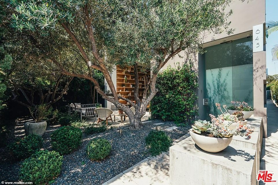 Drought friendly: There is also an area with gravel and shrubs that don't require much water; there are also cement squares to add a design element while voiding the need for grass