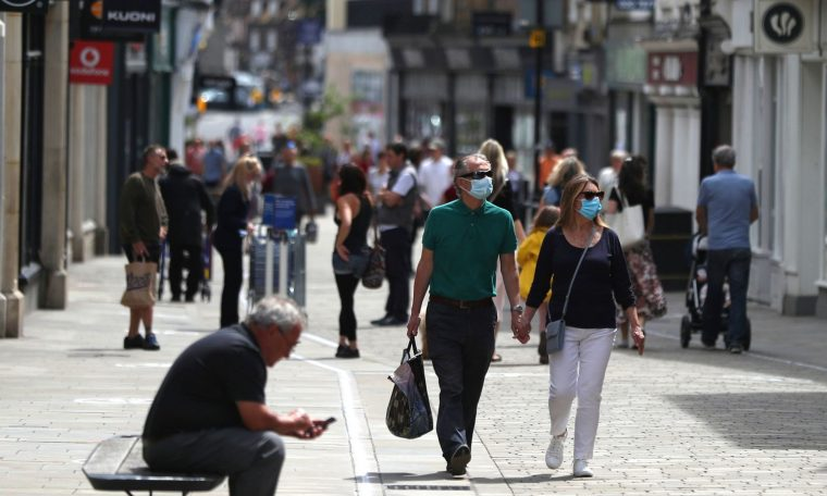 """Embargoed to 0001 Monday July 13 File photo dated 14/06/20 of people walking along the High street in Winchester. Retail footfall for June more than halved against the same month last year as shopper demand remains low despite the """"turning point"""" of reopening thousands more stores."""