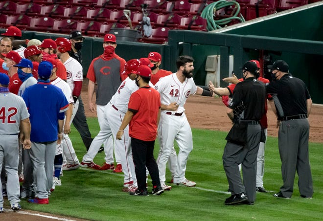 Cincinnati Reds left fielder Jesse Winker (33) argues with umpires as both benches clear in the fourth inning of the second game of the MLB double header between the Cincinnati Reds and the Chicago Cubs at Great American Ball Park in downtown Cincinnati on Saturday, Aug. 29, 2020.