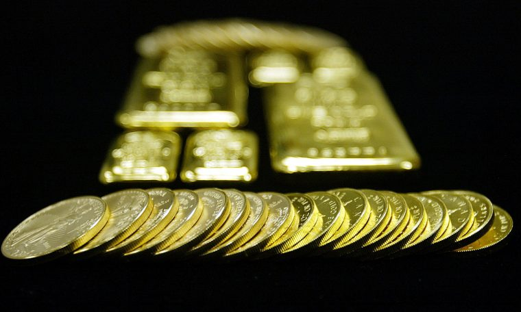 Gold declines for the session, posts first weekly loss since early June
