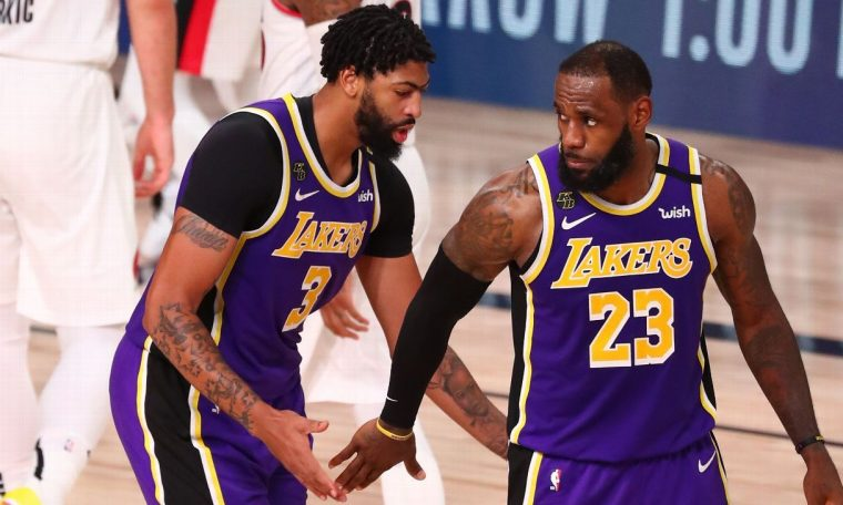 LeBron James, with Anthony Davis' help, passes Tim Duncan for No. 2 in playoff wins