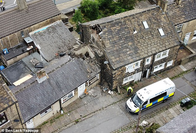 A 47-year-old man has died and a 28-year-old woman has been injured after their neighbour's chimney fell onto their house in Knight's Fold, Bradford, at 5.06am