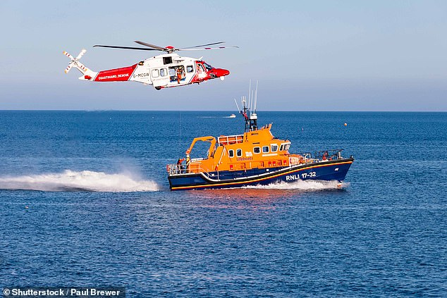 An RNLI life boat and helicopter in the English Channel (stock image)