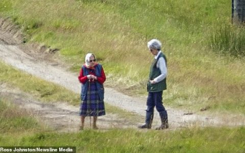 The Queen heads out for a walk as she is seen for the first time since heading to Balmoral Estate