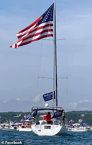 During the parade, a boat capsized waving Trump's 2020 flag
