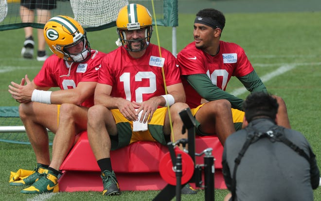 Green Bay Packers quarterback Aaron Rogers (12) is shown back-up quarterbacks Monday, August 24, 2020, and Jordan Love, right, Monday, 24, during the team's training camp at Ashwinbenen's Ray Nitsky Field.