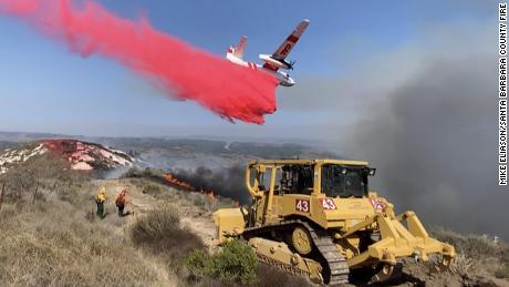 The bulldozer extinguished the blaze as a Calfire plane dropped a foss-check near a 110-acre fire at Vandenberg Air Force Base.
