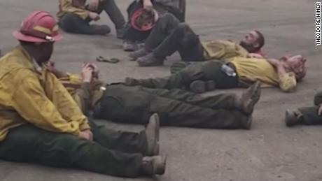 Tired firefighters sing together after a 14-hour shift in a wildfire fight in Oregon