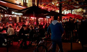 People are drinking on the terrace of a bar in Paris on September 26, 2020, two days before the new measures to prevent the spread of Covid-19 were implemented.