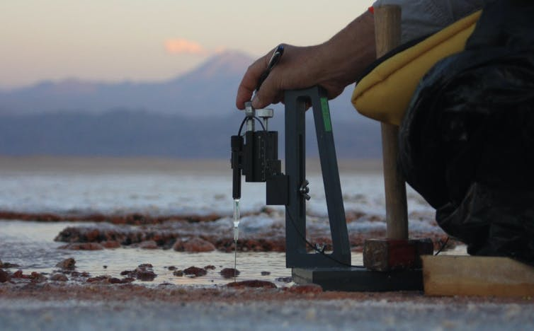 Peter Wischer using field gear to measure the chemical make of purple microbial mats.
